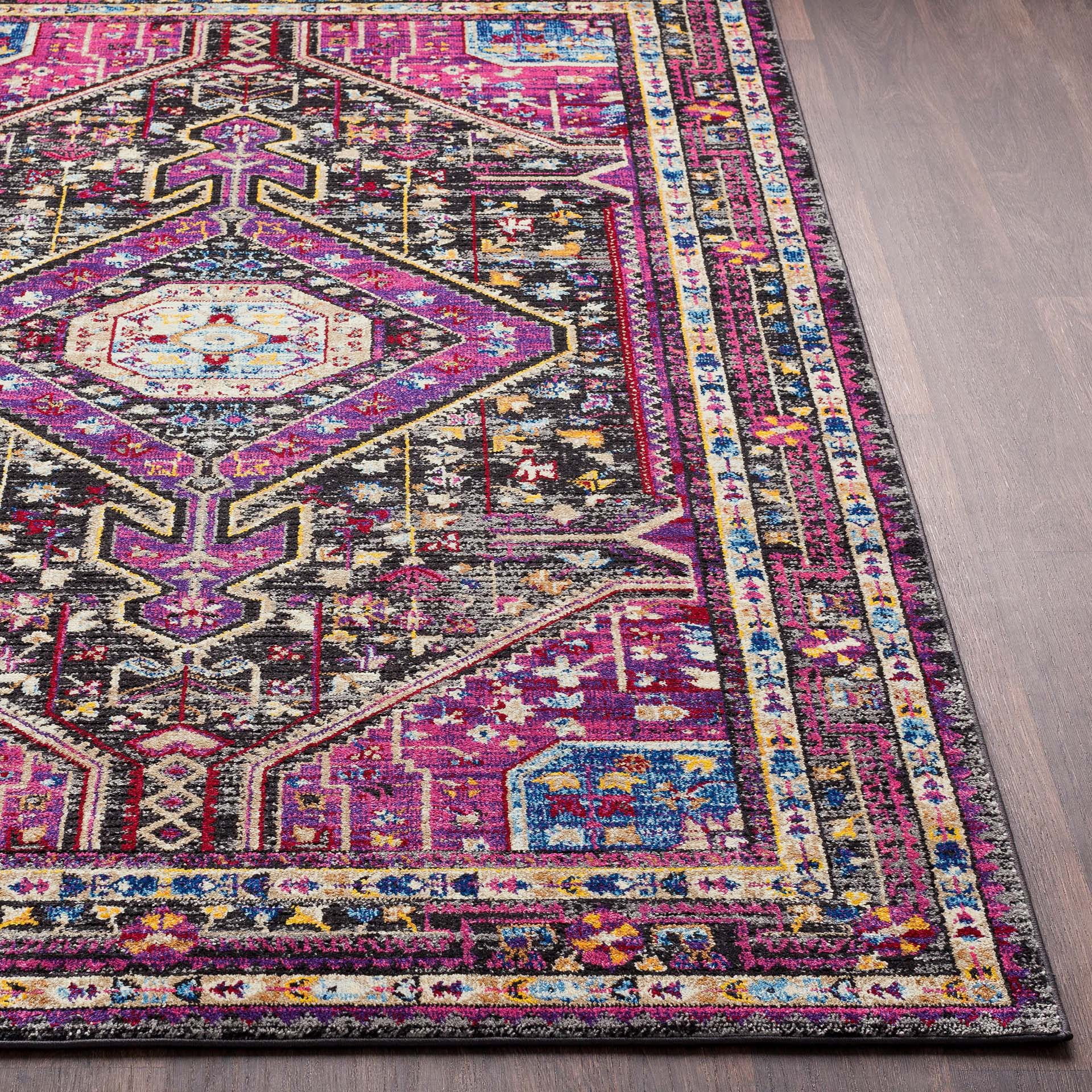Unique and colorful Turkish 5' x 7' area rug with strong hints of pink from the Alchemy collection - Side View