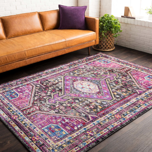 Unique and colorful Turkish 5' x 7' area rug with strong hints of pink from the Alchemy collection in Living Room