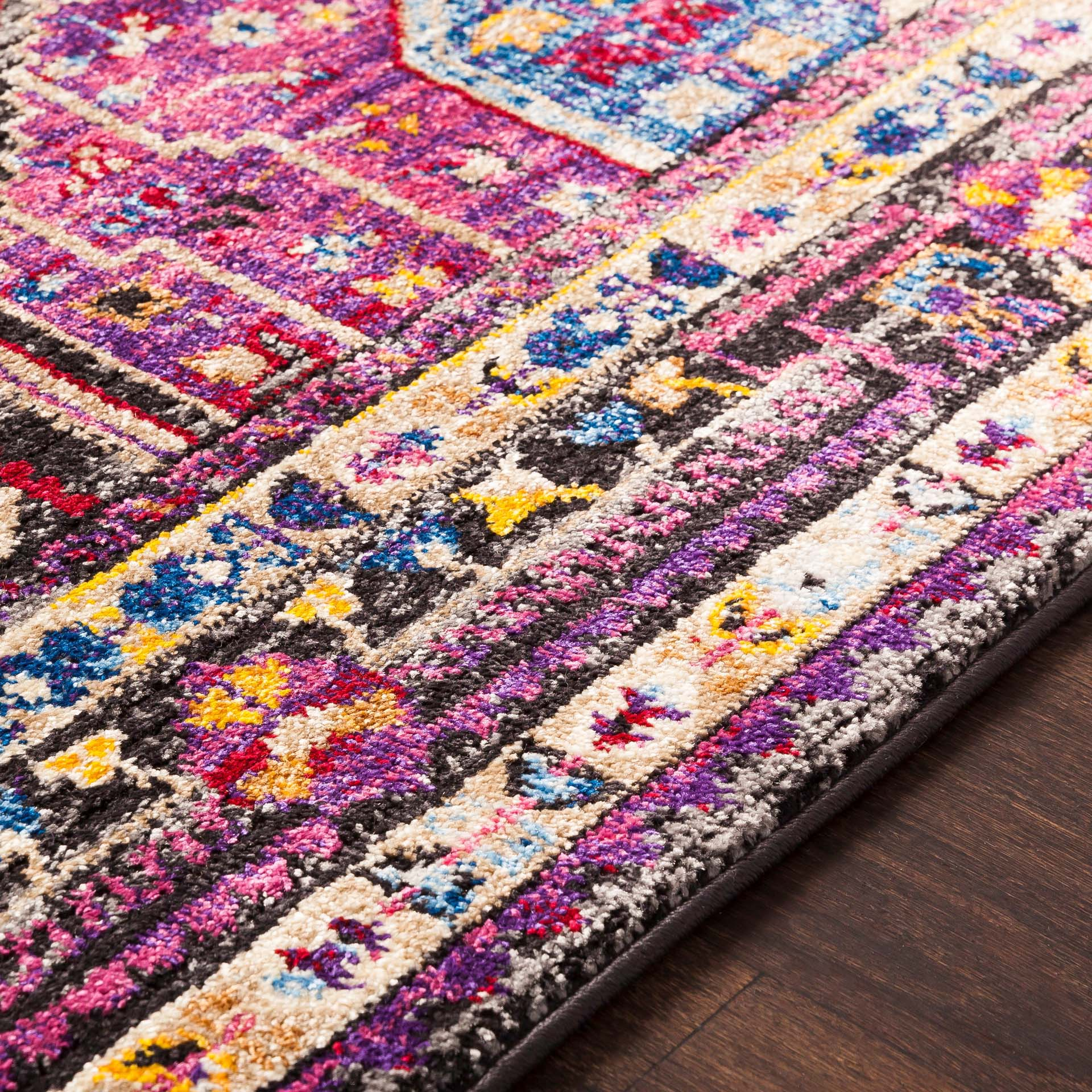 Unique and colorful Turkish 5' x 7' area rug with strong hints of pink from the Alchemy collection - Close Up