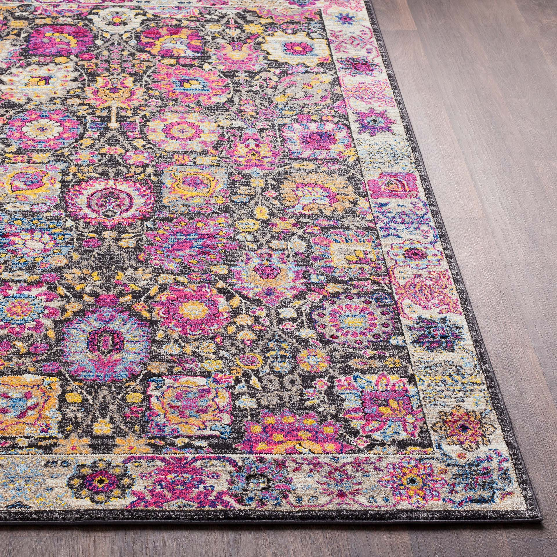Funky and colorful modern 5' x 7' area rug with bright pink, yellow, blue, violet and lime shapes on wood floor - Side View