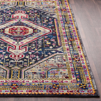 Colorful and unique 5 x 7 Turkish rug with hints of white and blue from the Surya Alchemy Collection  - Side Shot on Wood Floor