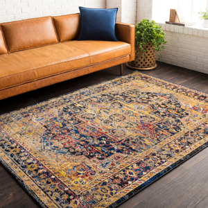 Unique Turkish rug with distinct yellow, blue and red pattern from the Surya Alchemy Collection in living room