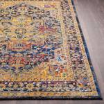 Unique Turkish rug with distinct yellow, blue and red pattern from the Surya Alchemy Collection- Close-up