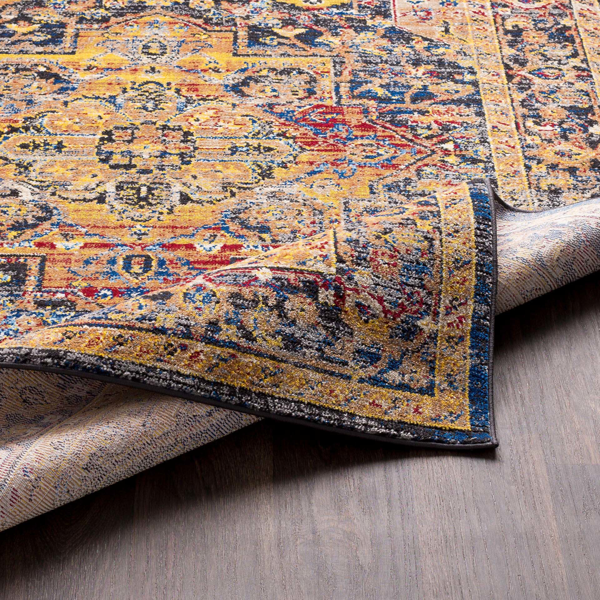 Unique Turkish rug with distinct yellow, blue and red pattern from the Surya Alchemy Collection - Backing  Close-up