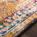 Unique Turkish rug with distinct yellow, blue and red pattern from the Surya Alchemy Collection - Detail View