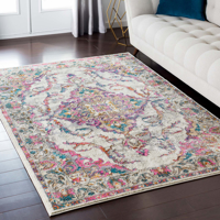 Classic Turkish area rug in ivory with pink, teal, gray and orange floral and ribbon pattern in living room