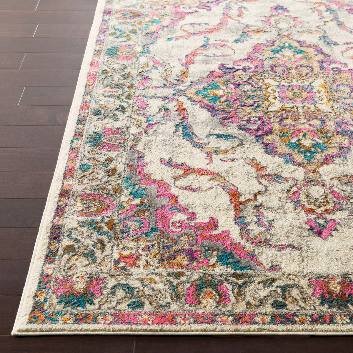 Classic Turkish area rug in ivory with pink, teal, gray and orange floral and ribbon pattern on wood floor