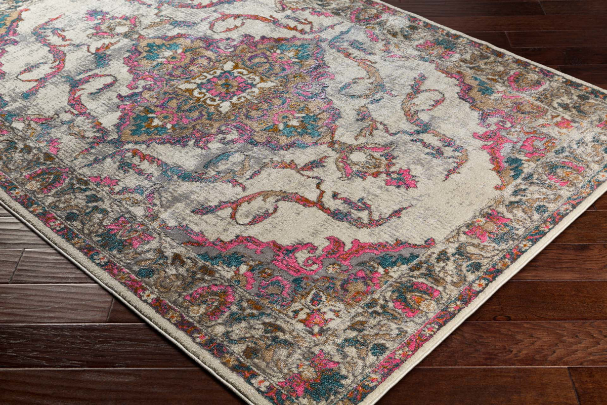 Classic Turkish area rug in ivory with pink, teal, gray and orange floral and ribbon pattern on wood floor2