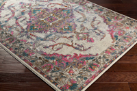 Classic Turkish area rug in ivory with pink, teal, gray and orange floral and ribbon pattern on wood floor	2