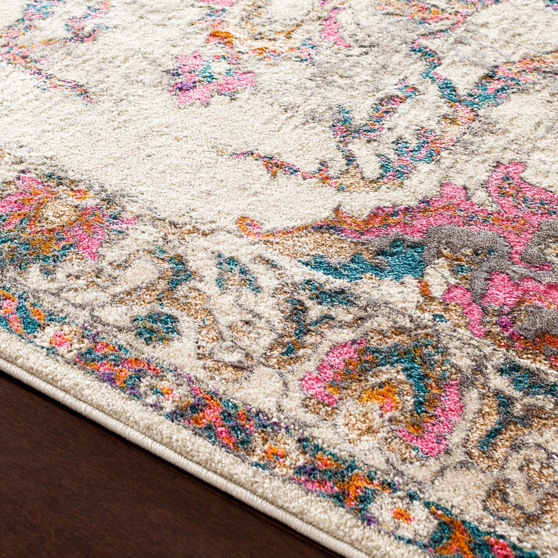 Classic Turkish area rug in ivory with pink, teal, gray and orange floral and ribbon pattern - Close up