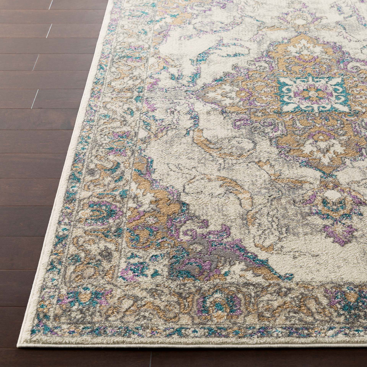 Classic ivory Turkish area rug with gray, purple and aqua ribbon and floral pattern on wood floor