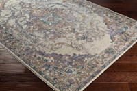 Classic ivory Turkish area rug with gray, purple and aqua ribbon and floral pattern on wood floor 2