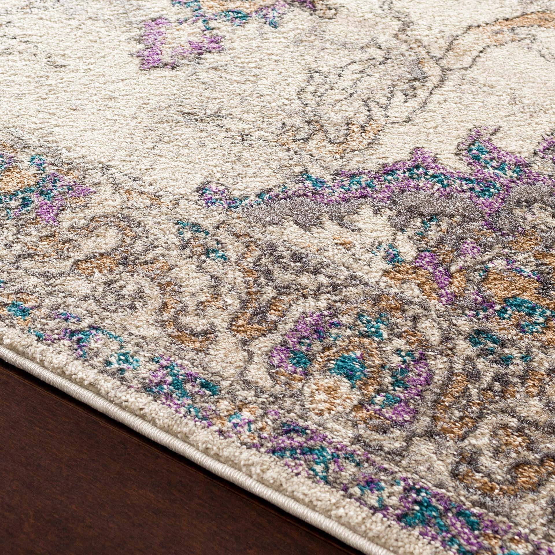 Classic ivory Turkish area rug with gray, purple and aqua ribbon and floral pattern - Close-up