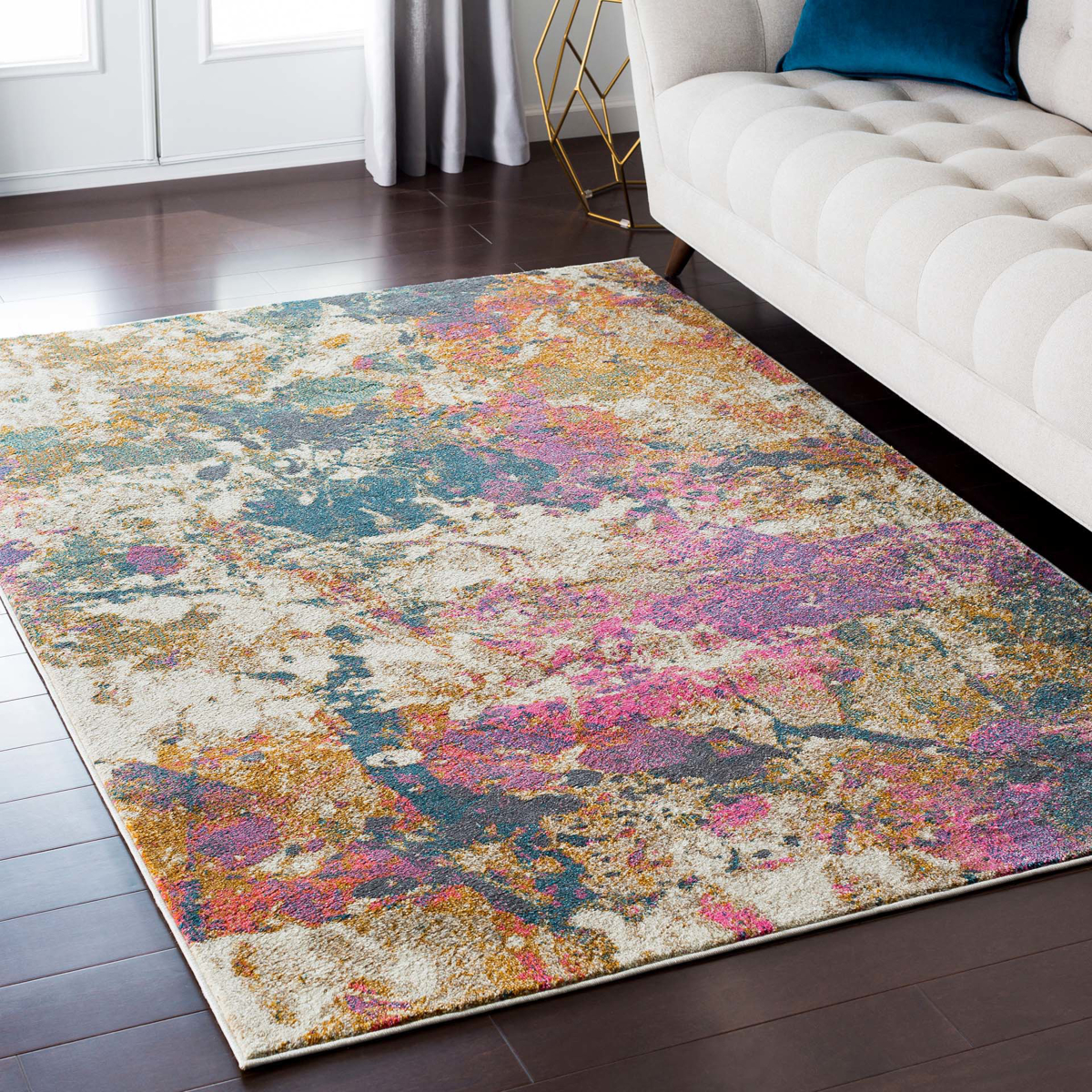 Abstract Turkish cream rug with splashes of pink, teal and orangein living room