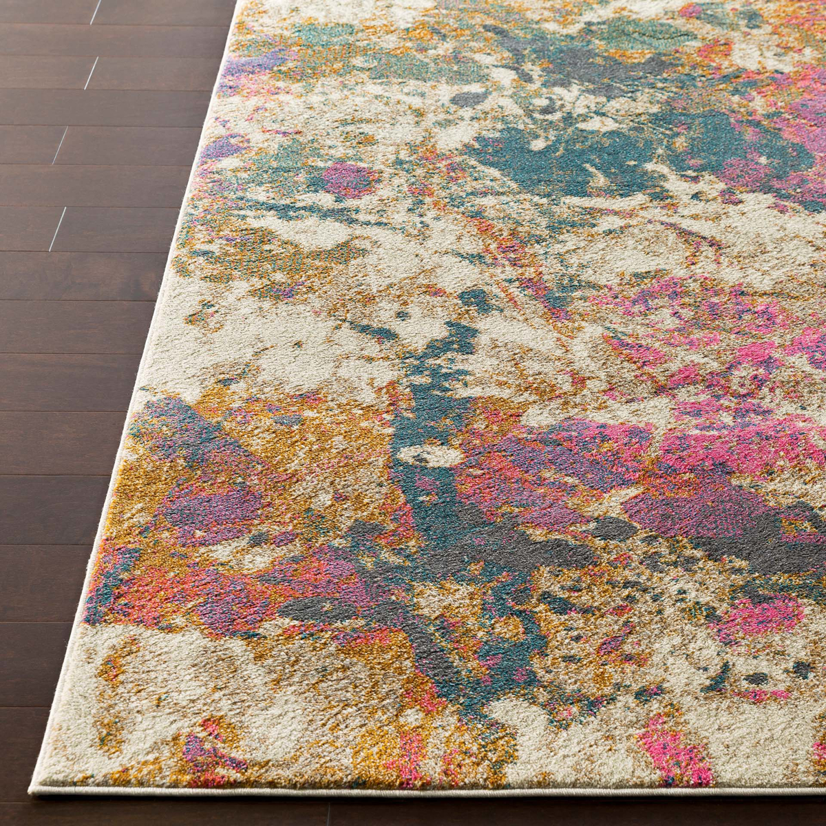 Abstract Turkish cream rug with splashes of pink, teal and orange on wood floor