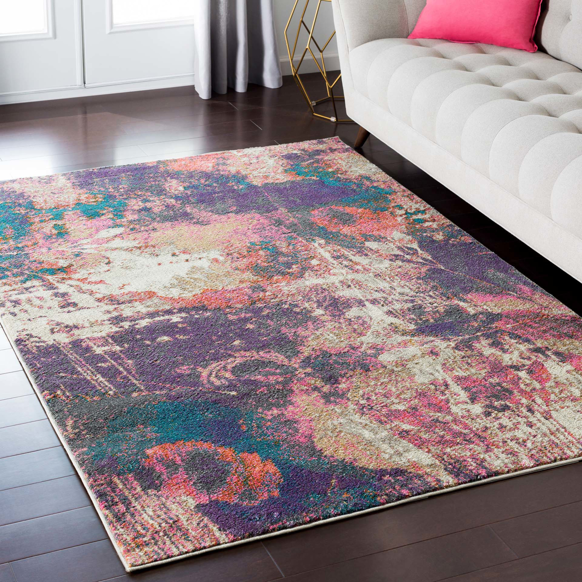 Abstract art inspired Turkish area rug with splashes of cream, purple, pink, orange and teal in living room