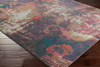 Abstract art inspired Turkish area rug with splashes of cream, purple, pink, orange and teal on wood floor 2