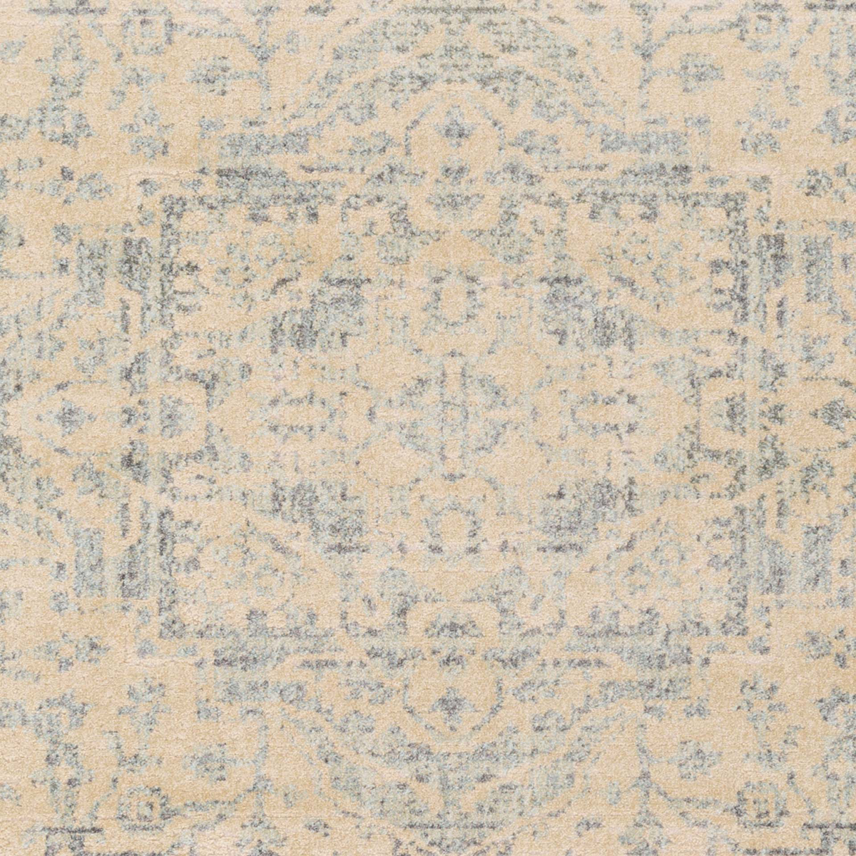 Neutral tone machine made Egyptian area rug in beige with hints of gray and green - Close Up