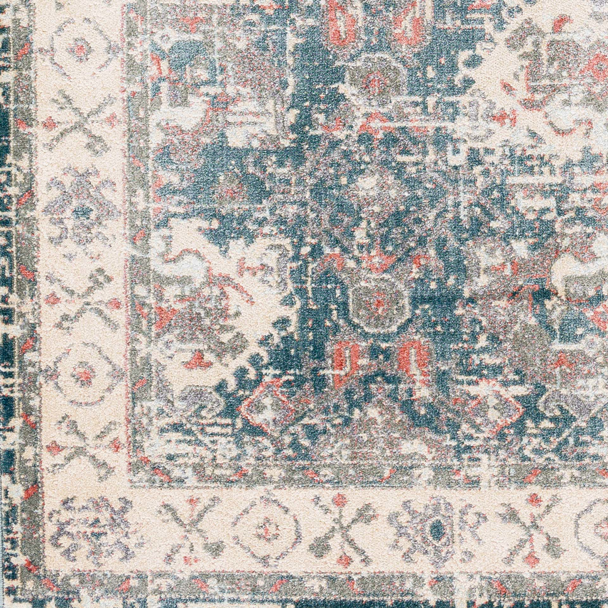 Neutral machine made Egyptian area rug with beige, green and pink accents	- Close up