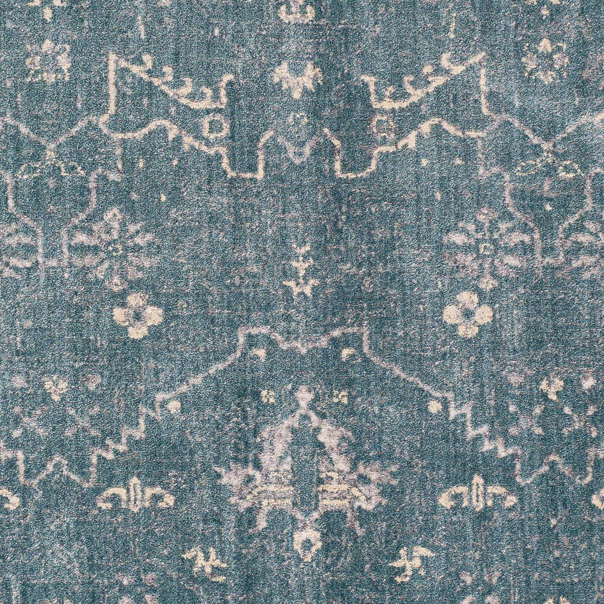 Modern machine-made Egyptian area rug in aqua with hints of beige	- Close up