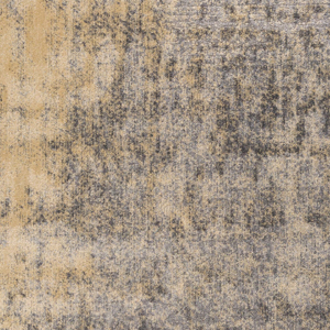 Neutral toned machine made Egyptian area rug with splashes of beige, cream and gray - close up