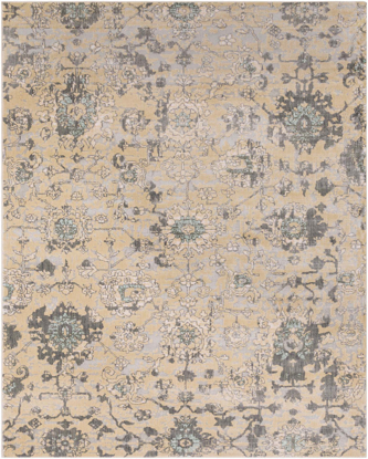 Neutral machine made Egyptian area rug in beige with hints of gray and green.