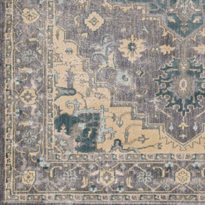 Neutral tone machine made area rug from Egypt with hints of gray, green and beige - Close up