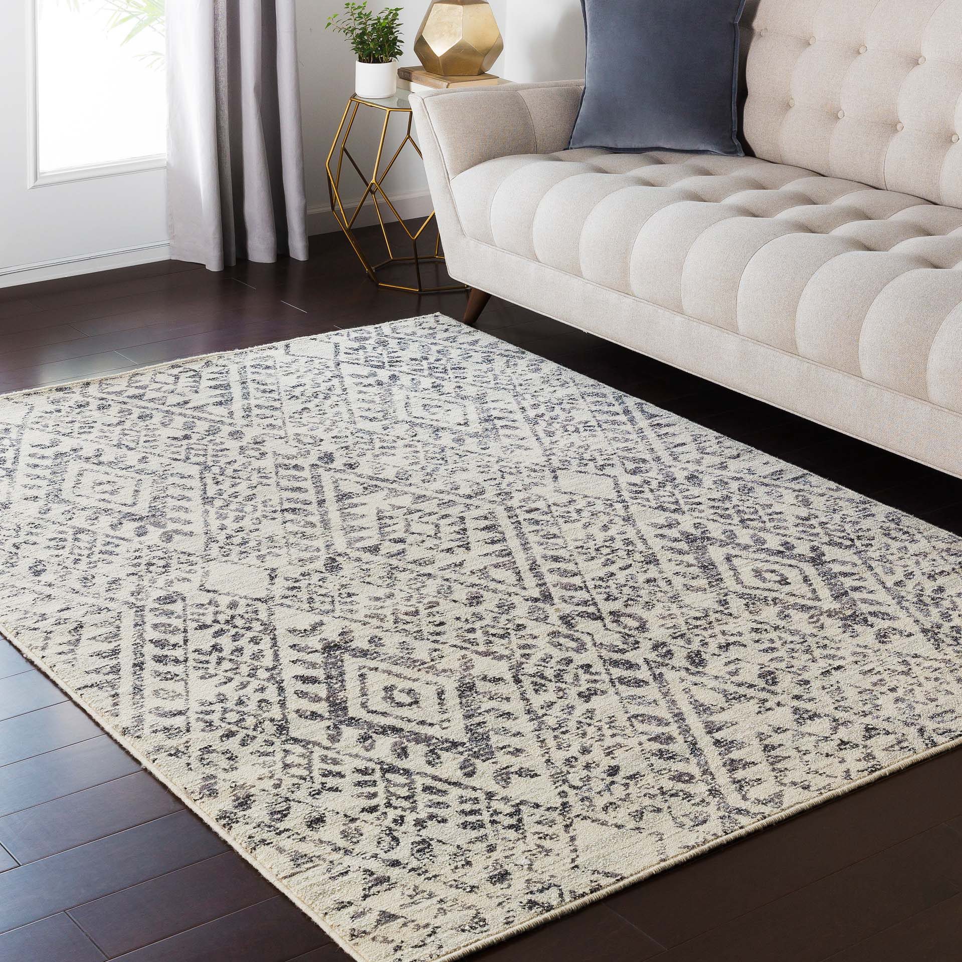 Surya Stretto polyester wool blend rug features an intricate black & cream diamond tribal pattern guaranteed to bring an edgy style to your living room.