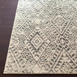 Surya Stretto Collection rug comes adorned from a polyester wool blend in an eye catching black & cream diamond tribal pattern perfect for your living room.