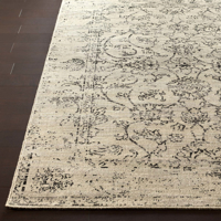 Polyester wool blend Surya Stretto area rug displays neutral tone colors with intricate black swirling details for a timeless classical look.