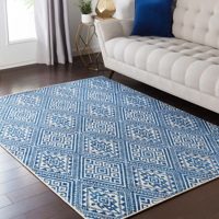 Surya Stretto polyester wool blend rug features an intricate violet and cream diamond tribal pattern guaranteed to bring an edgy style to your living room.