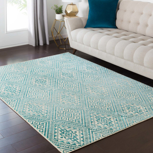 Surya Stretto polyester wool blend rug features an intricate teal and cream diamond tribal pattern that brings a bright trendy edge to your living room.