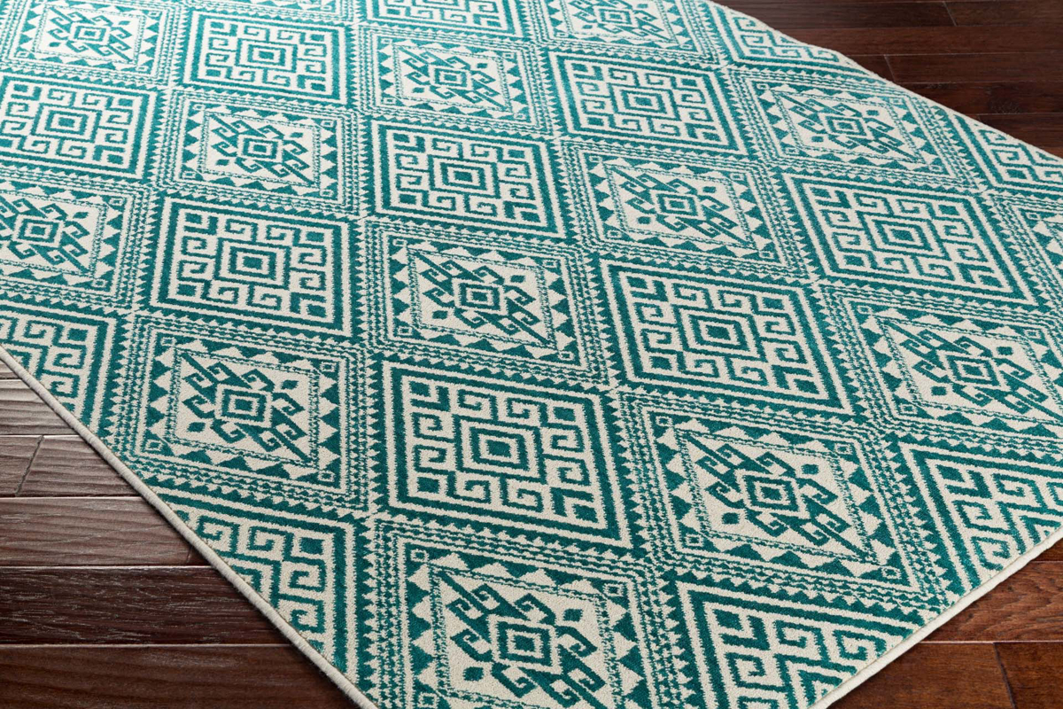 Surya Stretto Collection rug comes adorned from a polyester wool blend in an eye catching teal diamond tribal pattern perfect for your living room floor.
