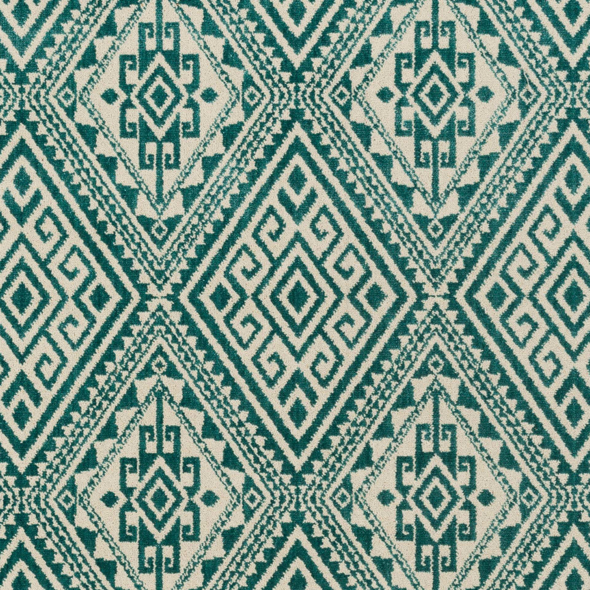 Polyester wool blend Surya Stretto area rug in a distressed teal and cream diamond tribal pattern for your living room floor decor.