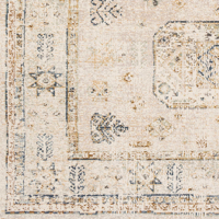 Neutral toned machine made area rug from Israel in beige with taupe, dark brown and green accents - Close Up