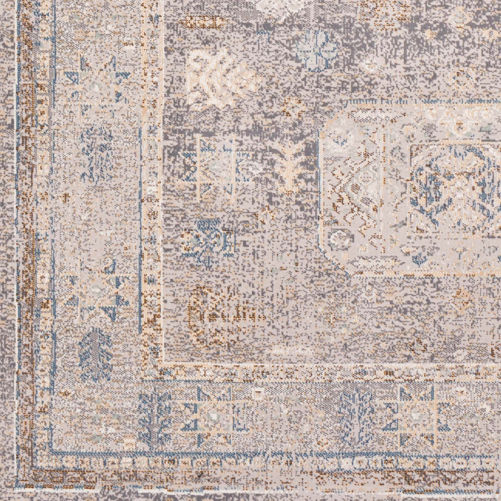 Neutral machine-made area rug from Israel with hints of beige, gray, blue and brown - Close Up