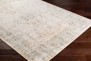 Traditional area rug with faded washed coloring in neutral tones on wood floor