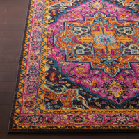 Trendy colorful 5x7 Turkish rug with hints of pink from the Surya Anika Collection on wood floor  - Closeup