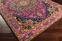 Trendy colorful 5x7 Turkish rug with hints of pink from the Surya Anika Collection - Side Shot