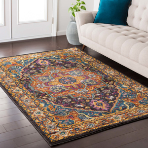 Trendy colorful Turkish rug with hints of blue and yellow from the Surya Anika Collection in Living Room