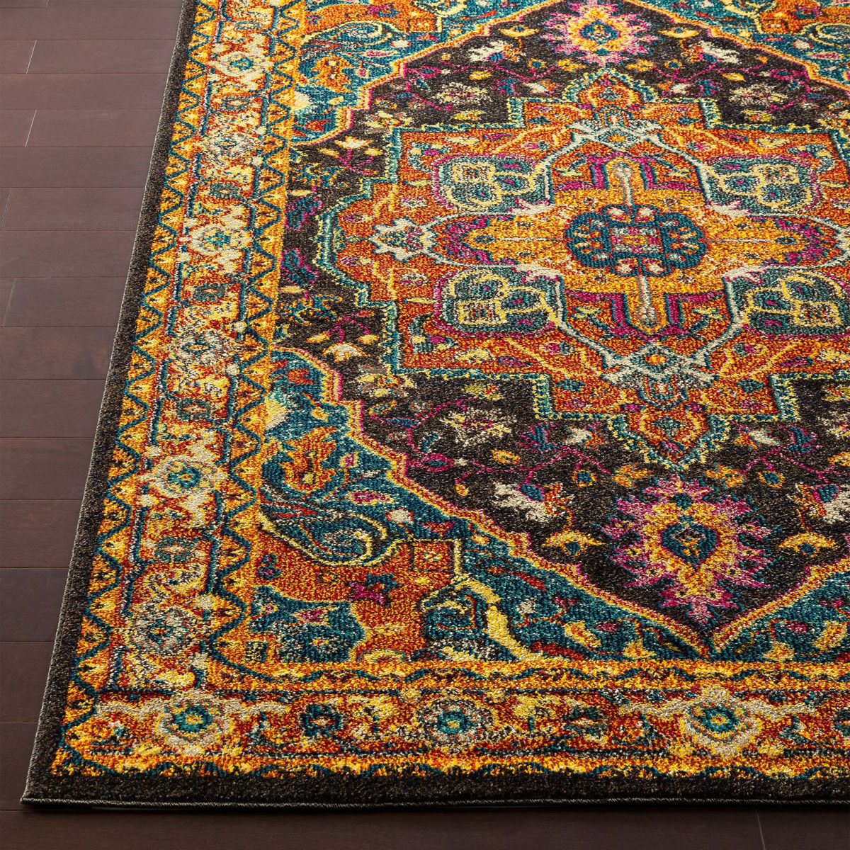 Trendy colorful Turkish rug with hints of blue and yellow from the Surya Anika Collection on wood floor