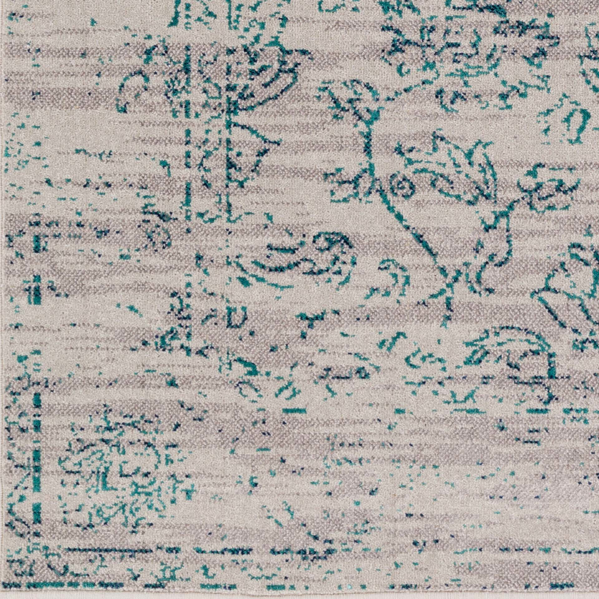 Machine made area rug from Israel in gray with teal flower accents - Close Up