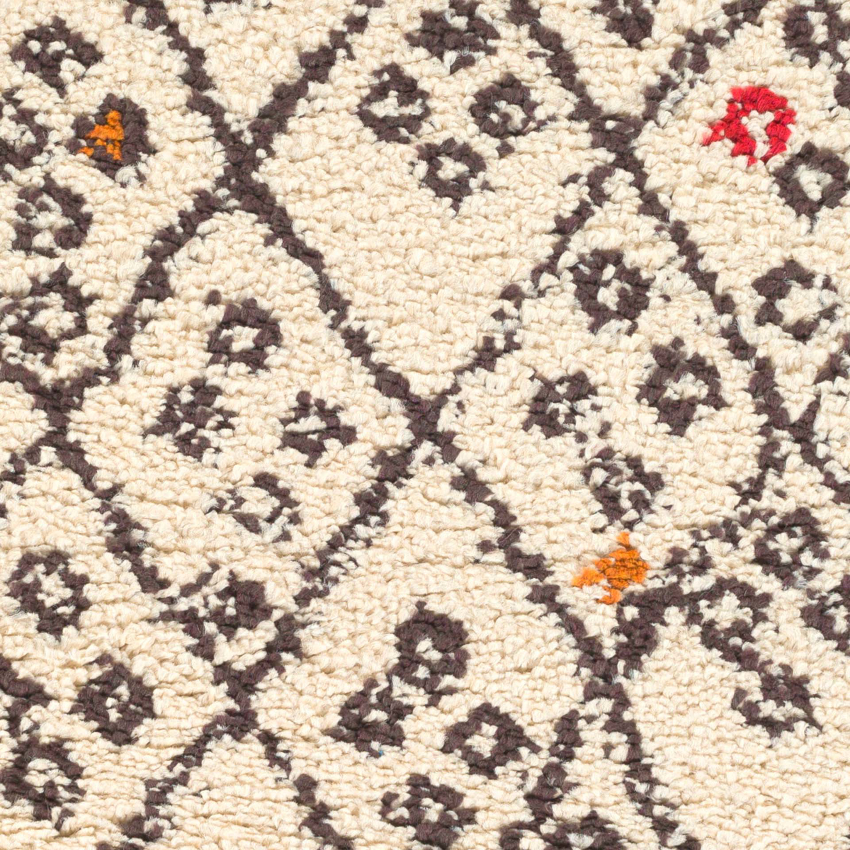 Handmade Surya Wilder Collection rug comes in khaki base with black diamond block pattern & speckled spots perfect for your living room floor decor.