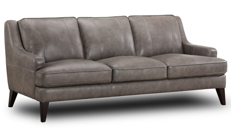 Stylish grey top-grain leather track arm sofa with feather down cushions atop dark wood feet