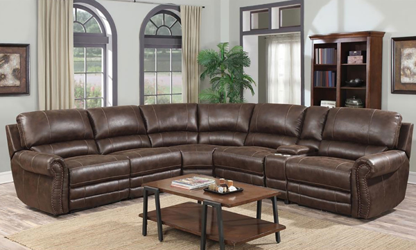 Brown top-grain leather reclining sectional sofa comes generously padded with deep seating, high back lumbar support, & nail head trim along the roll arms.