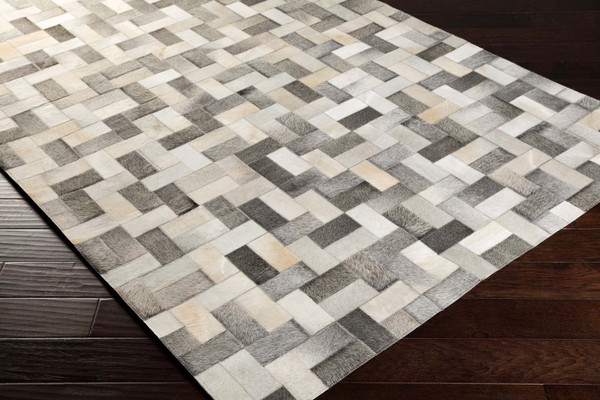 Handcrafted Surya Outback rug featuring Hair on Hide from India in gray, ivory and camel interwoven pattern.
