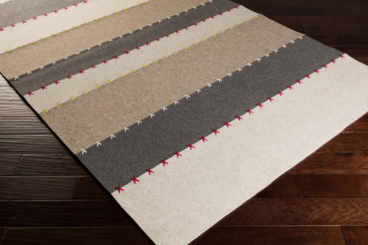 Shop the Surya Thread Collection rug with Intricate Indian wool felted patchwork in a striking neutral tone striped pattern perfect for your floor decor.
