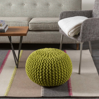 Handcrafted Surya Thread Collection rug comes adorned in felted wood from India in a natural earth tone striped pattern.