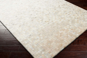 Handcrafted Surya Trail 8x10 rug featuring Hair on Hide from India with khaki, ivory and beige tile pattern overtones.