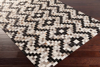 Handcrafted Surya Trail rug featuring Hair on Hide from India, black & white overtones, & spot only cleaning accompanied with a 1 year warranty.